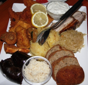 Platter of hearty food at the Christ Heuriger