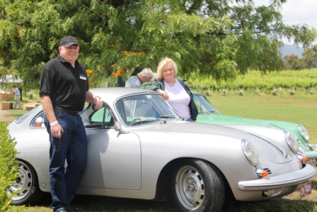 Meg and Brendan with their vintage Porsche.