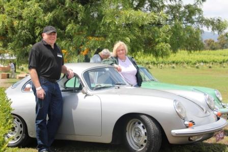 Meg and Brendan with their vintage Porsche.