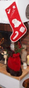 My childhood Christmas stocking and  a prized gift from my mother, a Santa trimmed with mink.