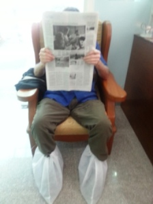 BB waits in dentist office number 2.  Shoes must come off, but instead they covered his.  Fear of stinky feet?