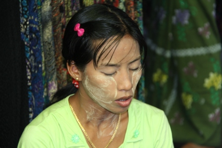Women smear their faces with a paste made from logs.  It acts as a sun block and moisturizer.
