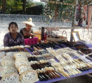 Souvenir sellers on the beach where  mother of pearl items are popular.