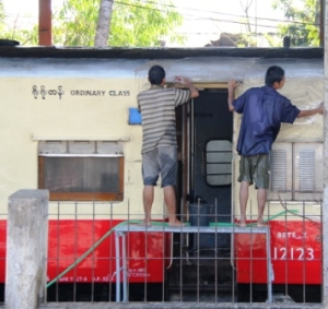 Cleaning a train car at Yangon station.