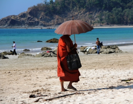 Visiting monk from Thailand where monks wear orange.