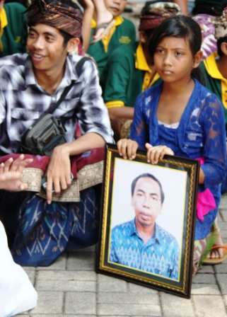 With photo of deceased at cremation ceremony.