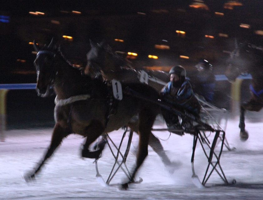"More horse racing on the lake. The ""carriage"" behind the horse is on skis."