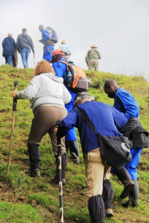 Porters help with the ascent.