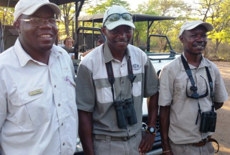 Abiot, center, with fellow guides in Zimbabwe
